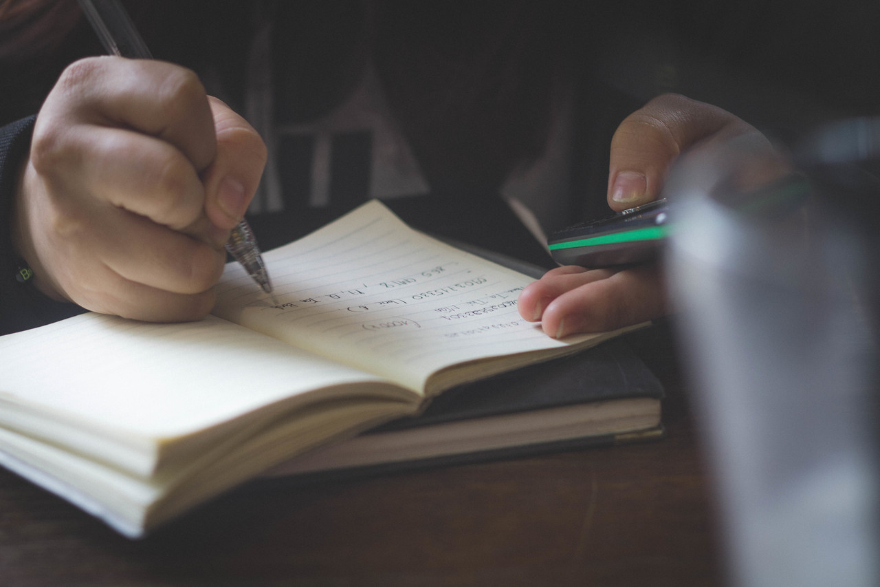 A student making notes in a notebook