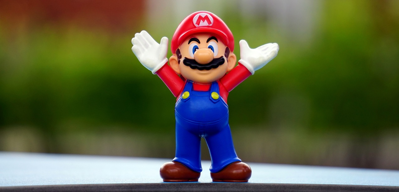 Super Mario toy figurine expressing joy