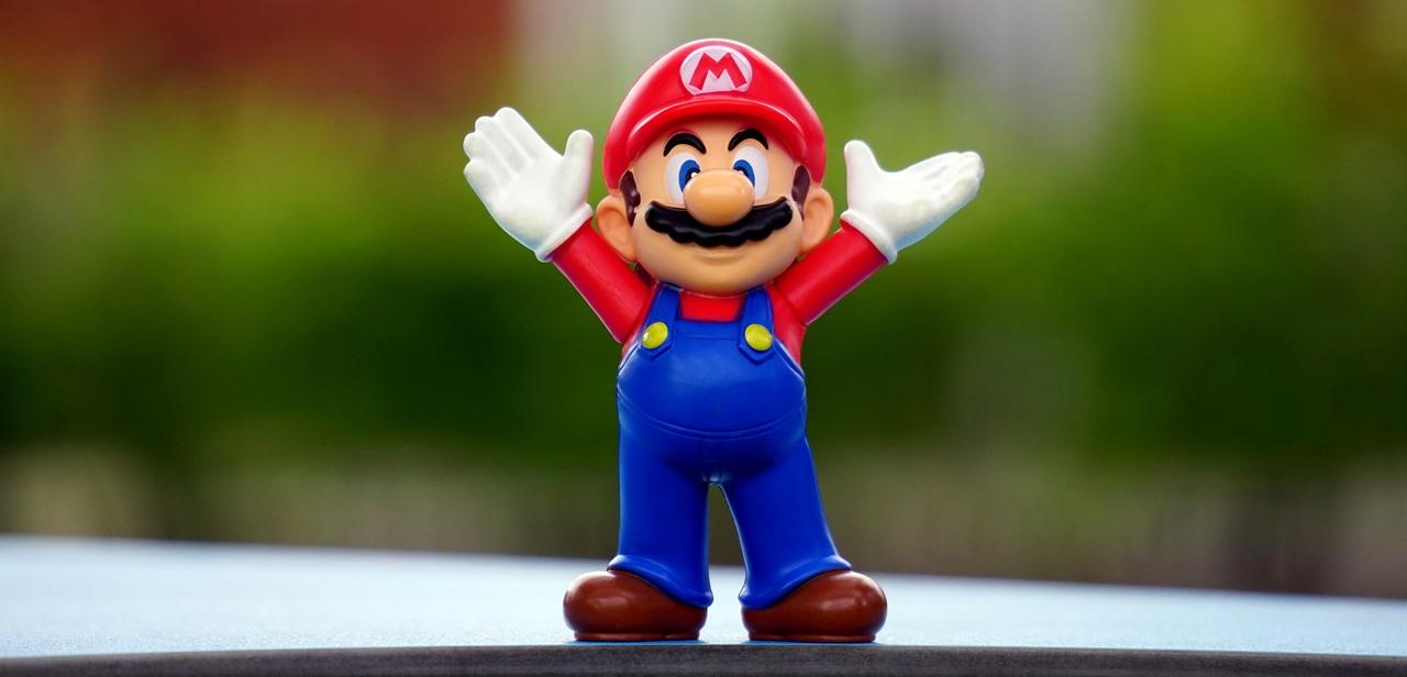 Super Mario toy figurine expressing joy