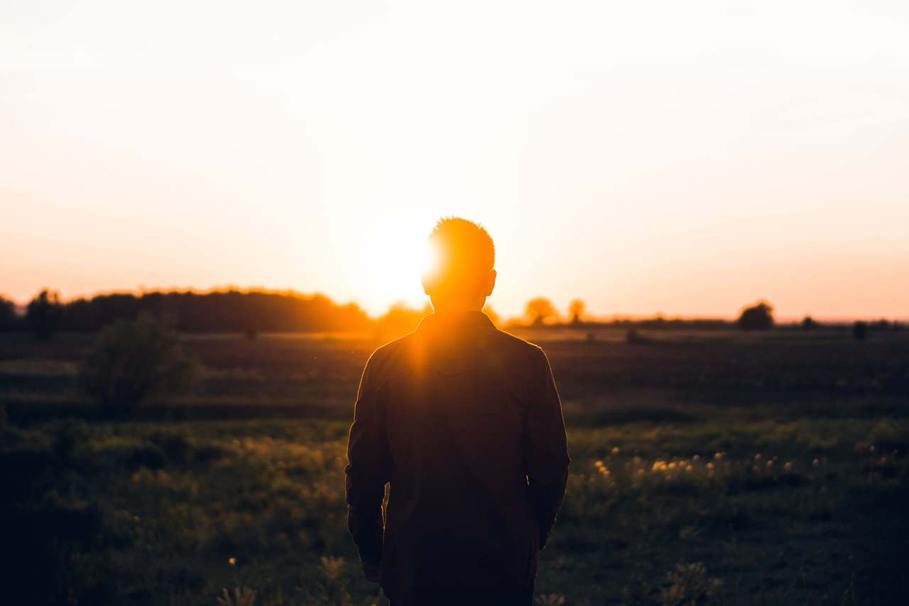 Sunrise with man staring into the sun