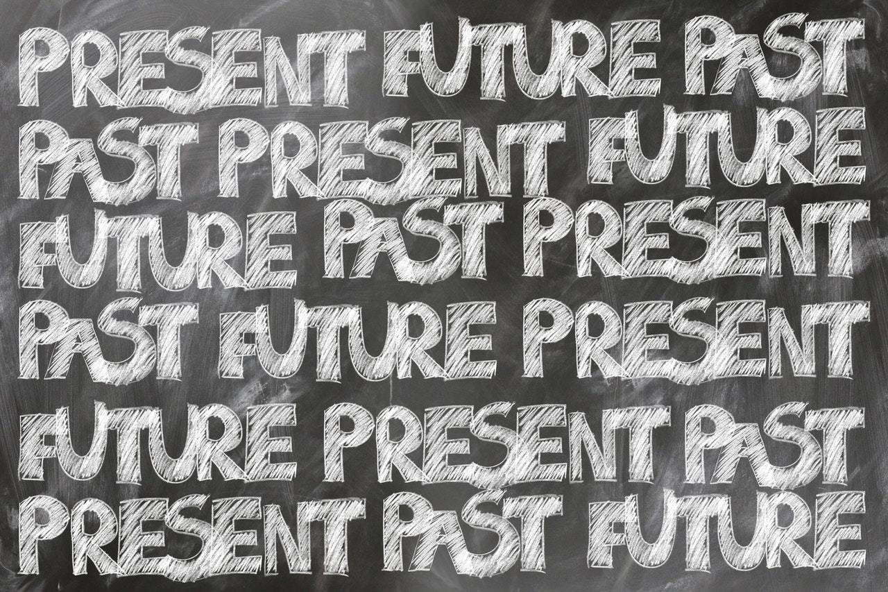 English grammar tenses written on a blackboard