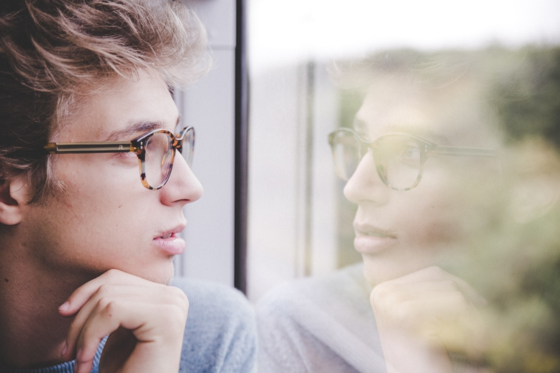 boy with glasses thinking