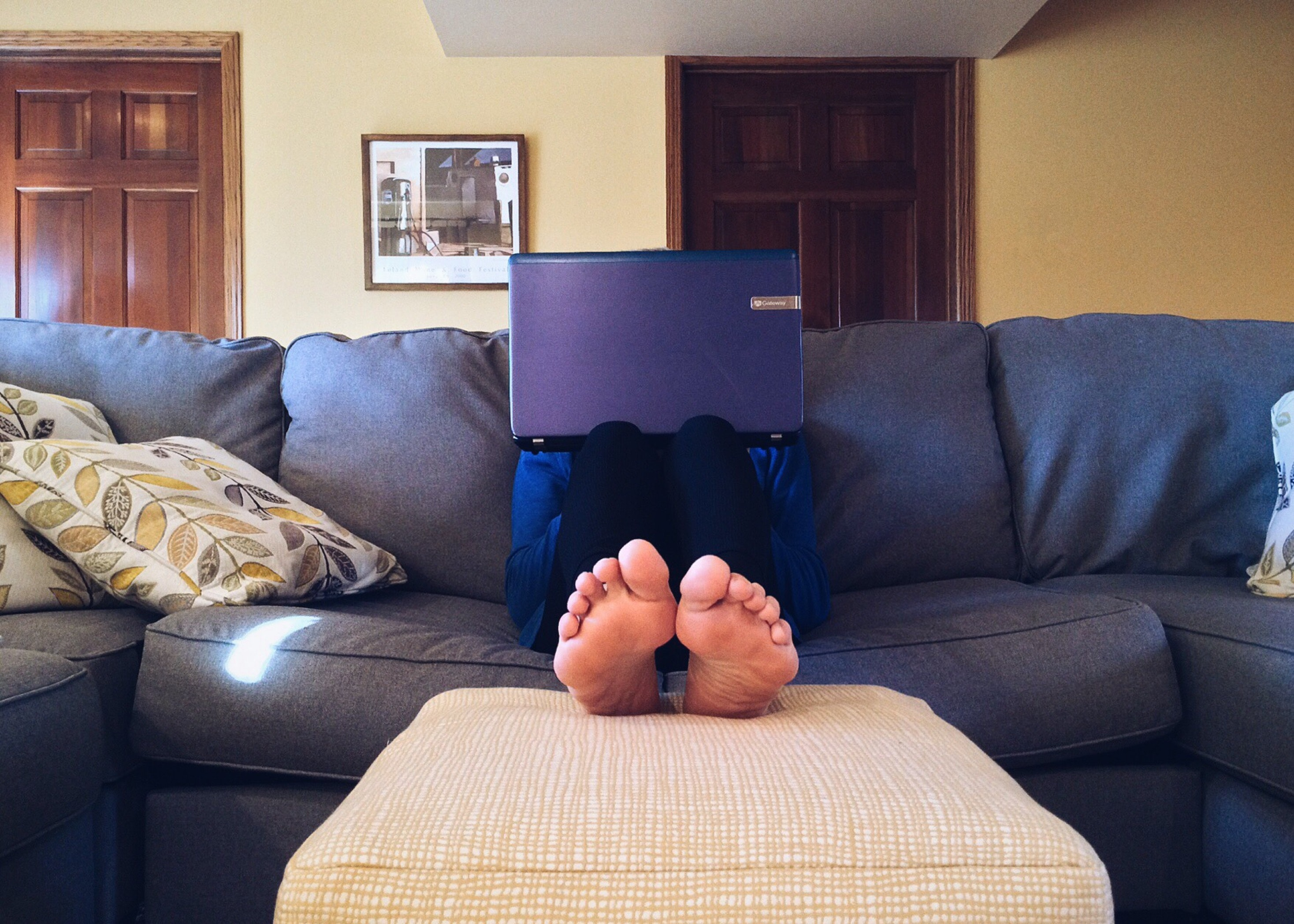 Guy with notebook on couch