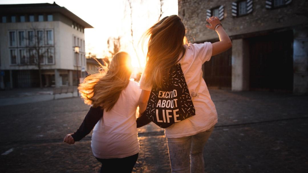 Walking on the street towards sunset