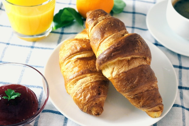 breakfast with croissants and orange juice