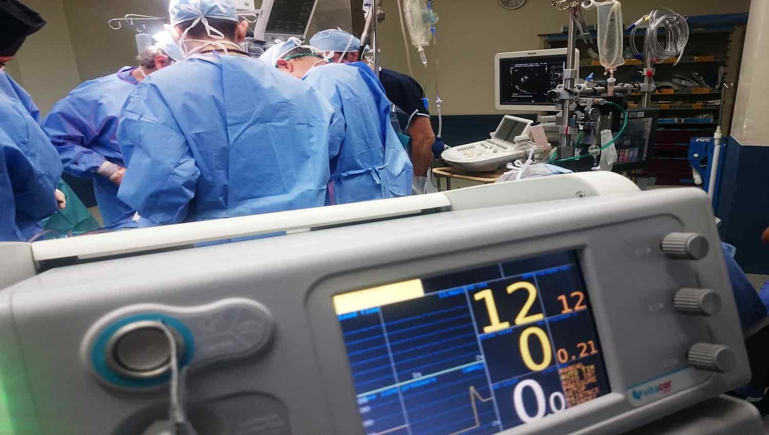 Doctors working on a patient in an operating room