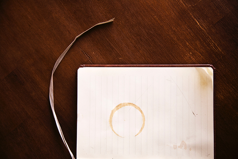 Notebook with Coffee Stain Working Hard
