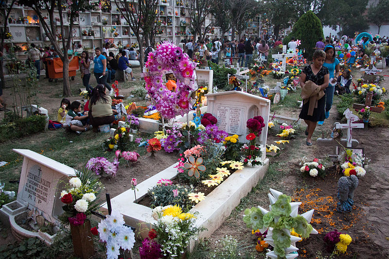 cemetery during day of the dead full of colors