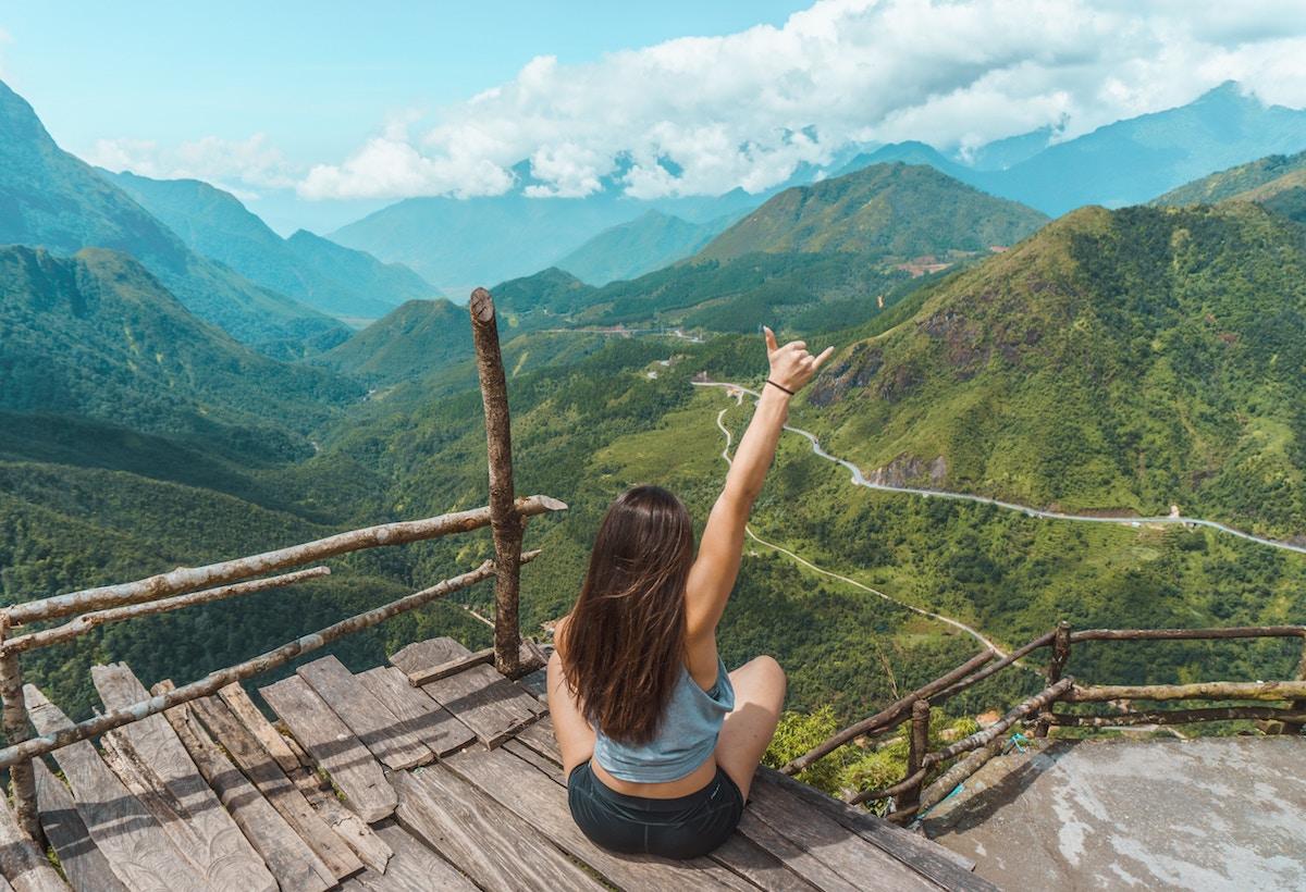 Girl gesturing on a bridge