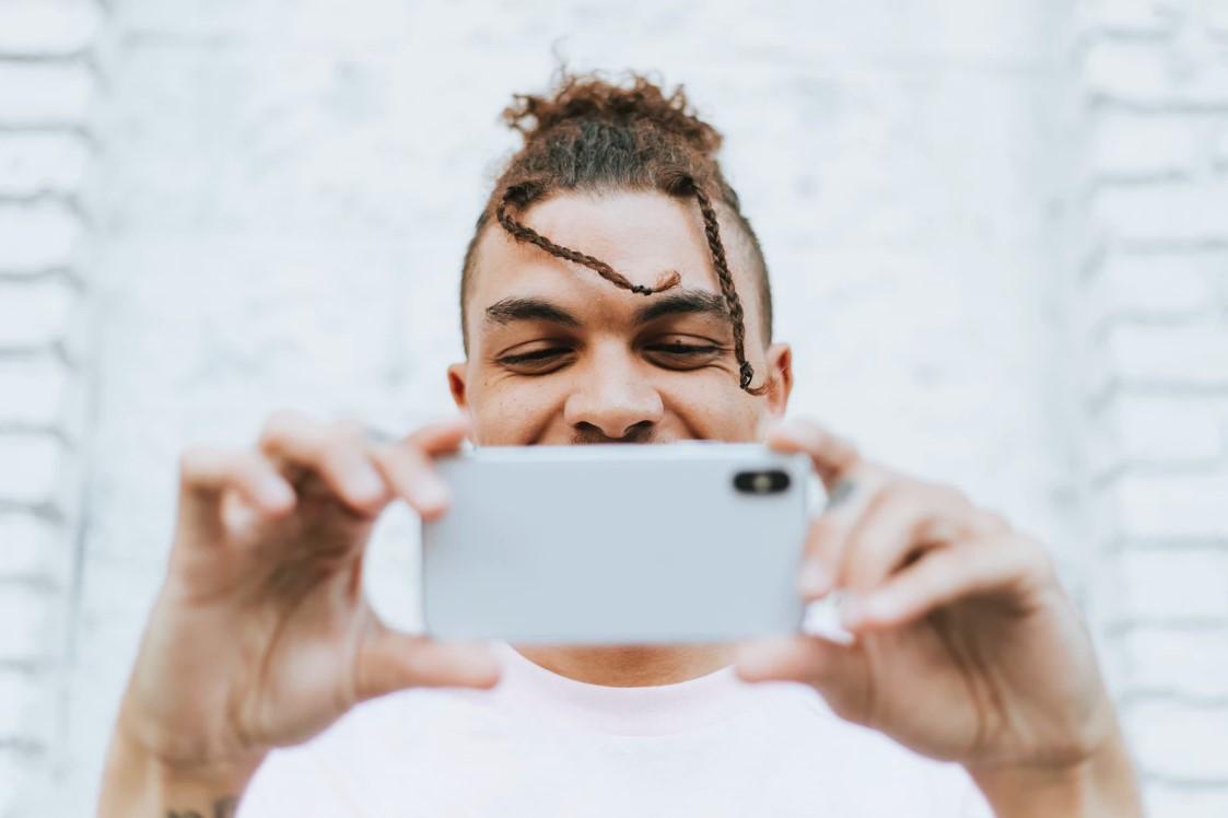 man speaking on phone via video call