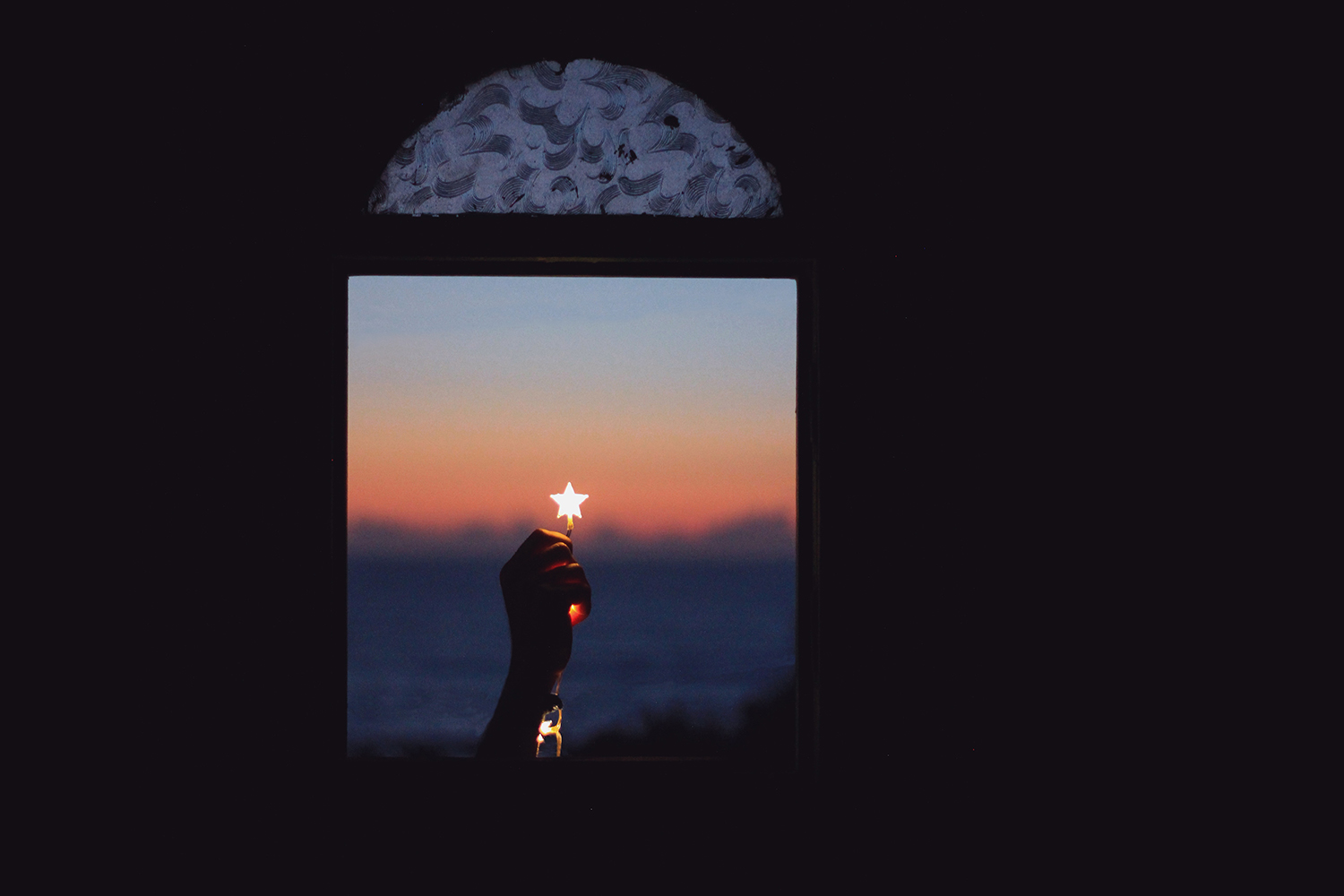 Star in a Window Held By a Hand