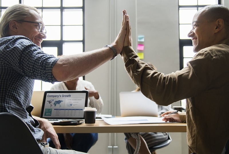 High Five at a meeting