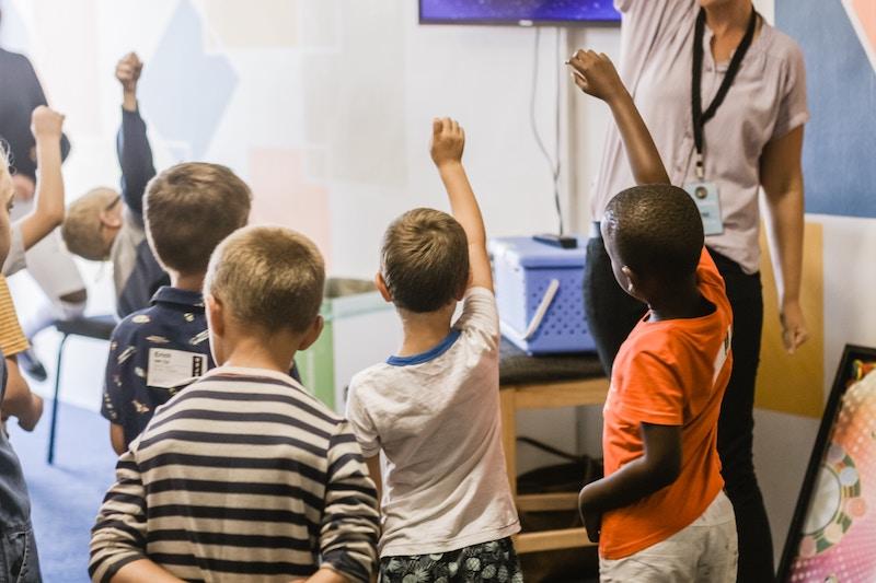 Kids Standing Around Teacher