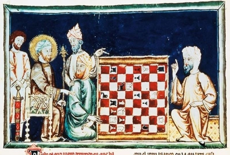 Two peopel show a chessboard