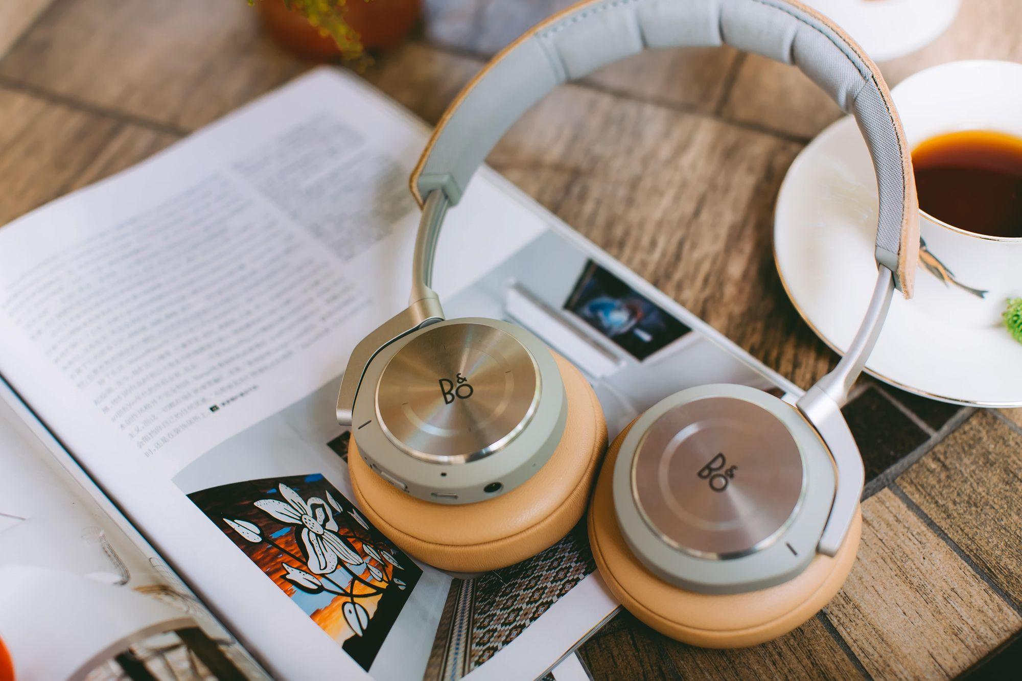 Book, headphones, and a coffee cup