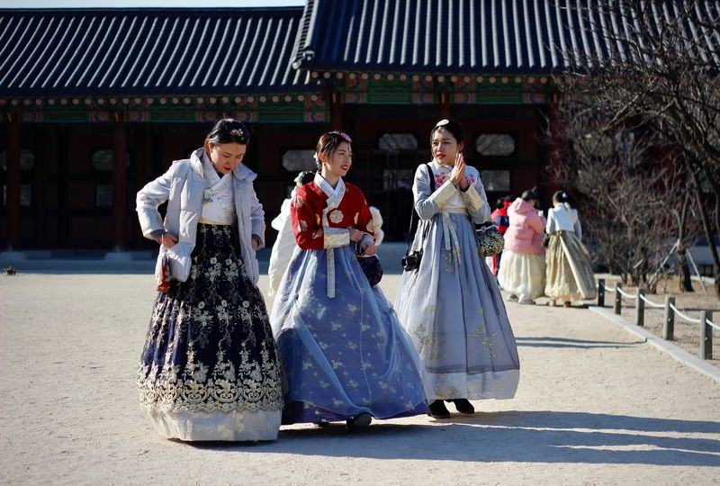 Three women in traditional Korean dresses