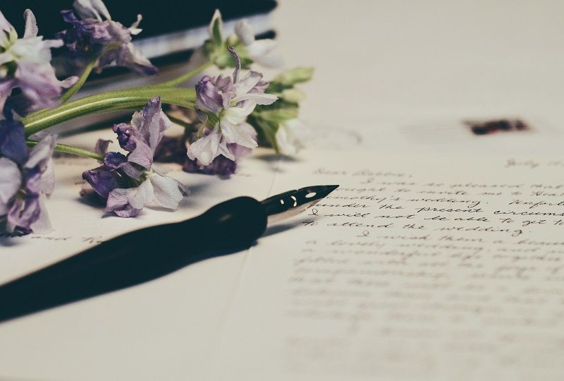 A written letter and some flowers