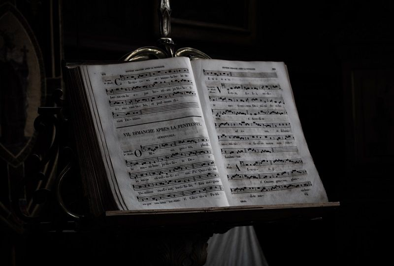 Sheet music with lyrics in French on a stand