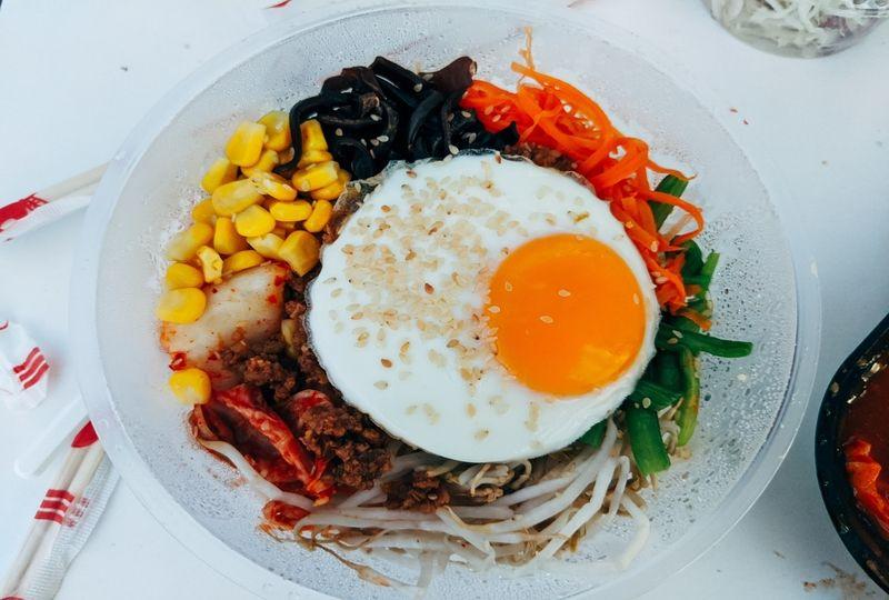 Egg over a bowl of vegetables