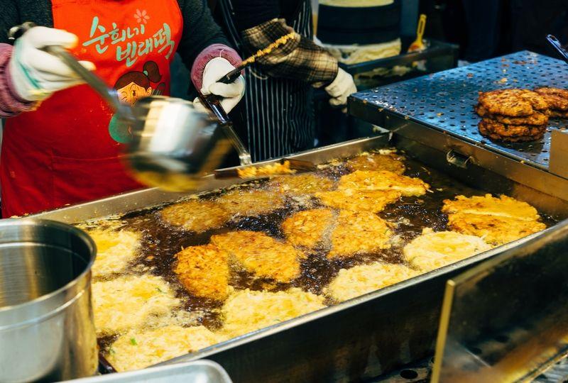 Woman cooking Korean pancakes