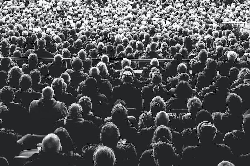 People Sitting In A Audience