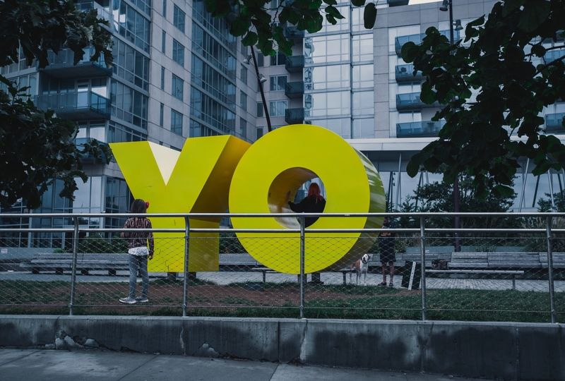 Yellow letters saying YO behind a fence