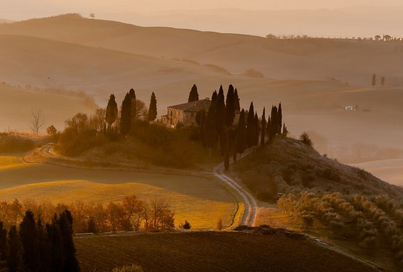 Dawn over a farmhouse in the Tuscan countryside