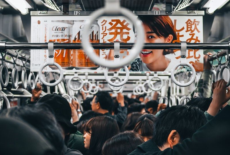 people standing inside train