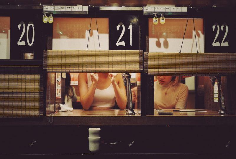 photo of two women in restaurant