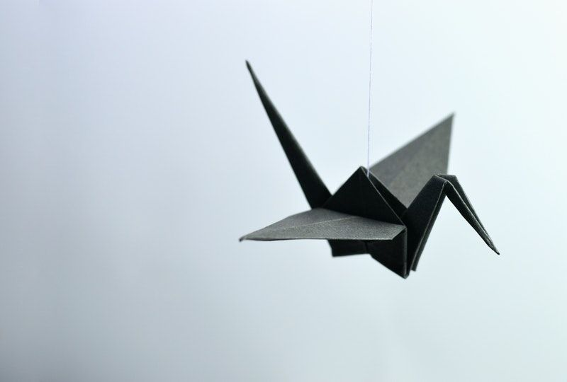 paper crane on a string