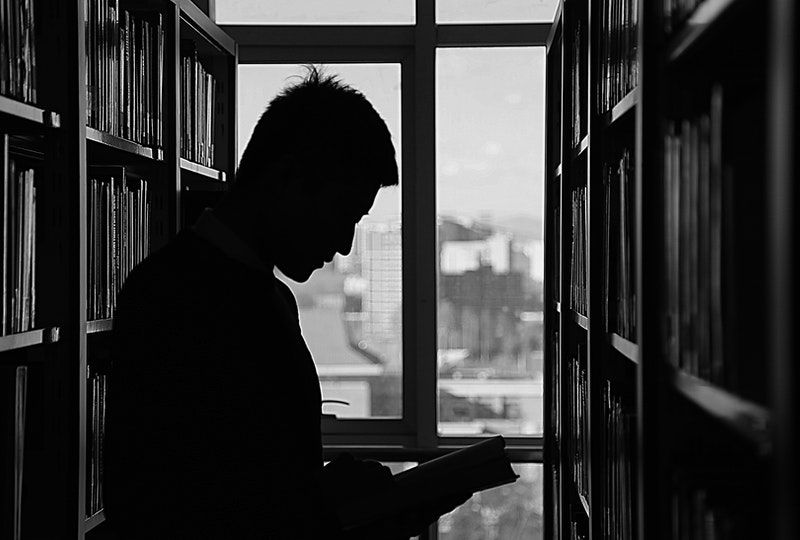 silhouette of man reading