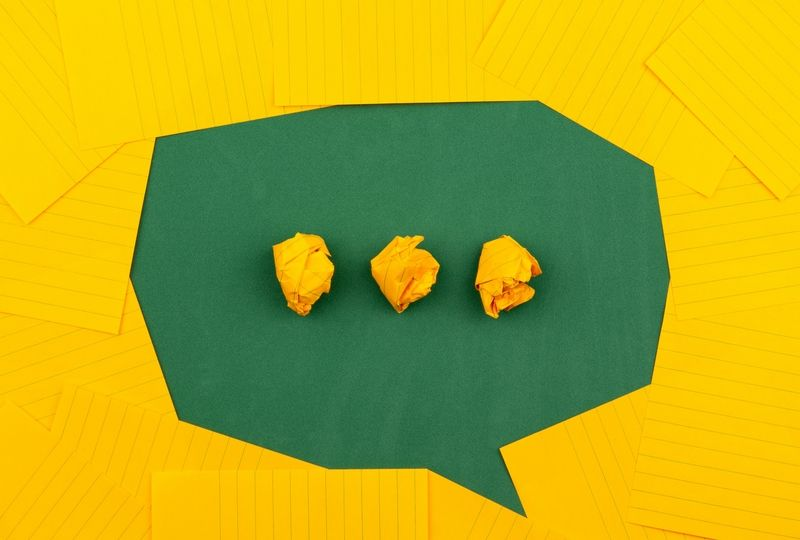 Green speech bubble with yellow ellipsis