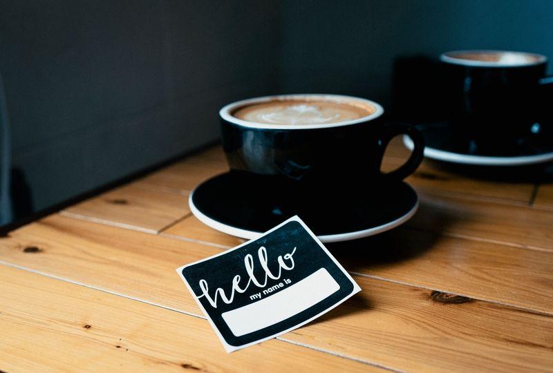 Hello sticker next to coffee mug