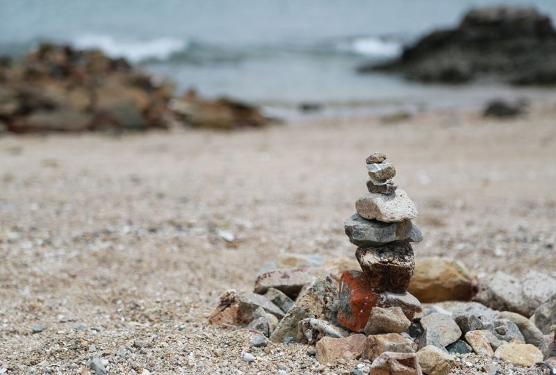 Rocks stacked in the sand