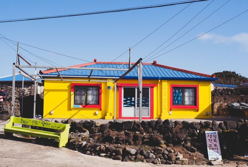 Yellow house with blue roof