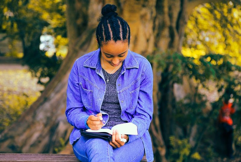 A woman practising Italian writing
