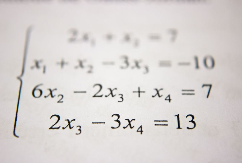 Math equation on white paper
