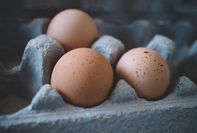 three eggs in a carton