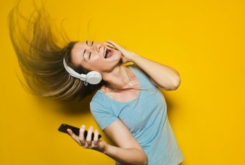 A girl enjoys Brazilian songs