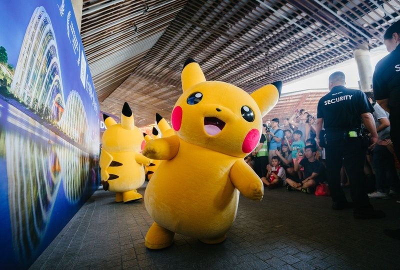 Pikachu characters interacting with people