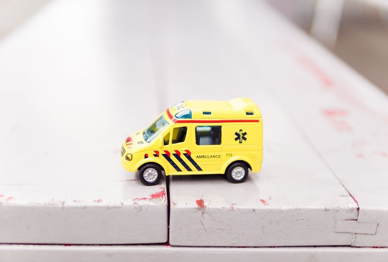 Yellow toy ambulance