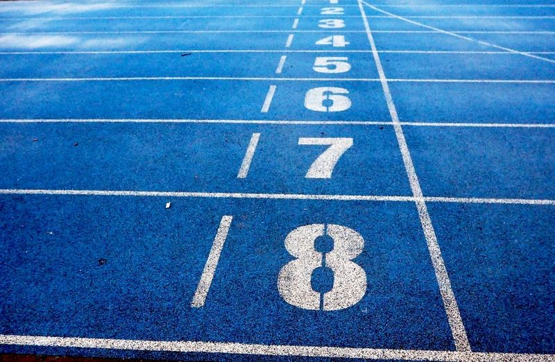 a blue race track with painted numbers