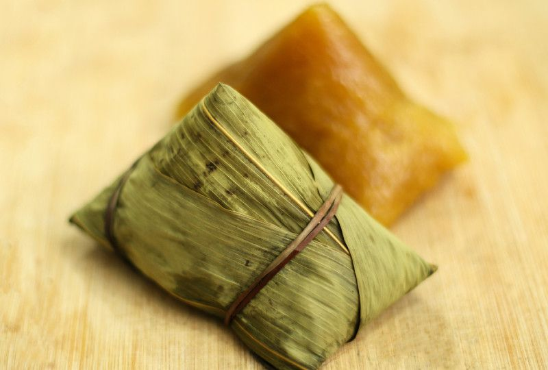 Wrapped and unwrapped sticky rice dumpling