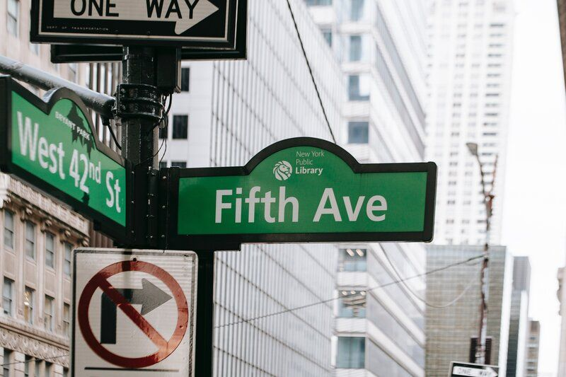 new york street sign saying fifth ave