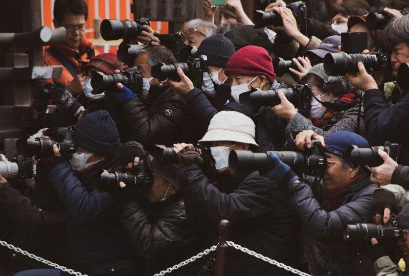 paparazzi taking photos