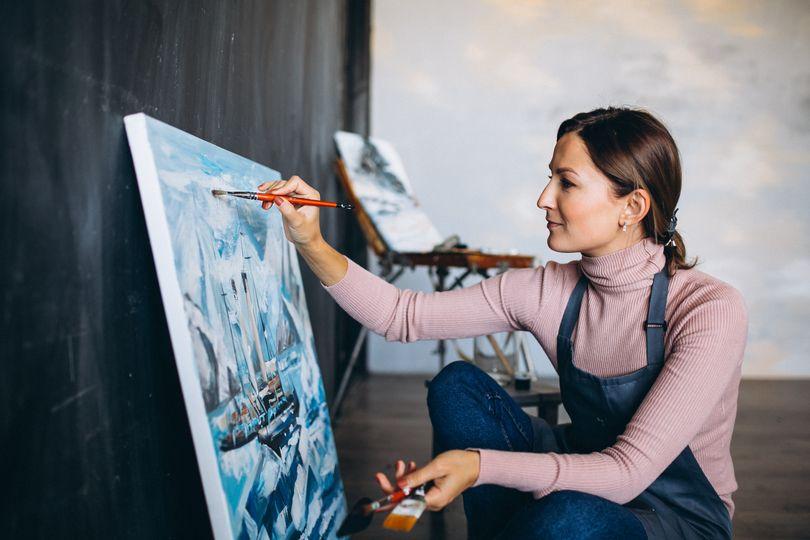 female artist painting studio