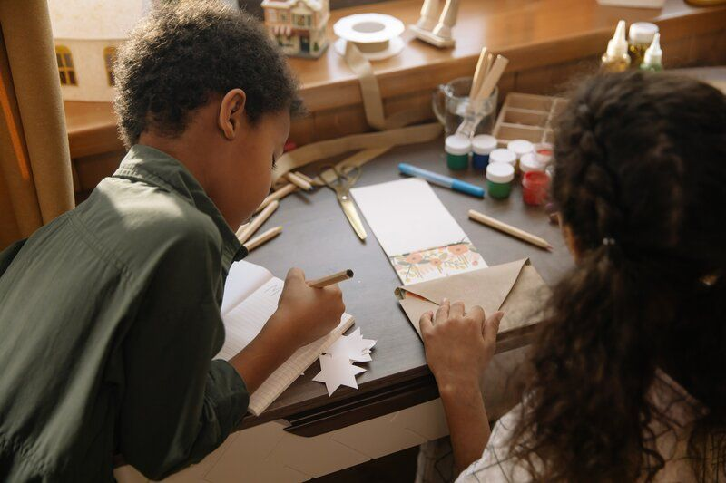 two children writing letters