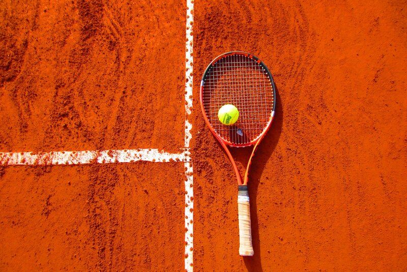 picture of a tennis raquet and ball