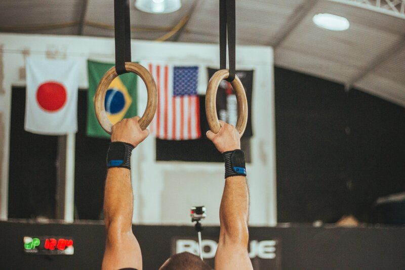 a gymnast holding onto rings