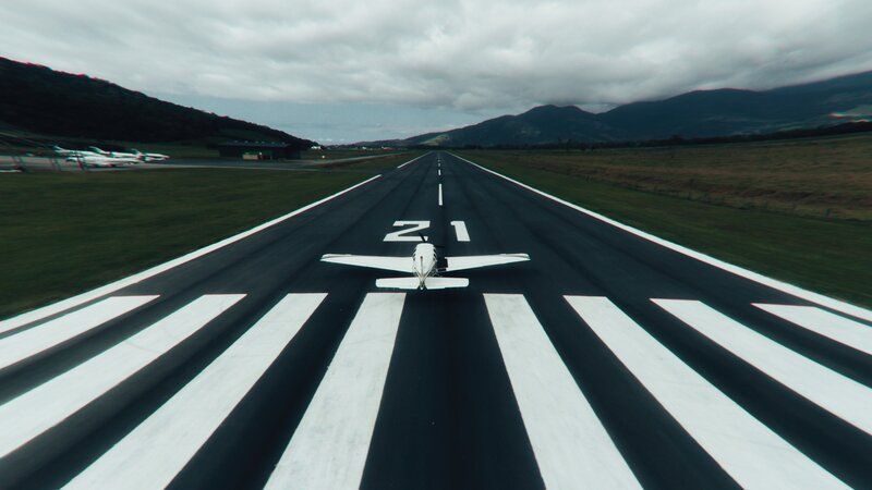 a plane on a runway about to take off